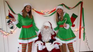Santa Claus with two cheerful elves
