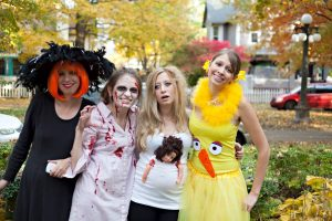 Witch, zombie, pregnant, and big bird costumes for Halloween