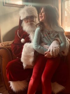 Santa Claus with Little Girl on his lap